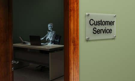 futile: Skeleton sitting at a desk, concept for non existent customer service Stock Photo