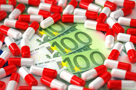 Medical concept showing capsules with hundred Euro bills photo
