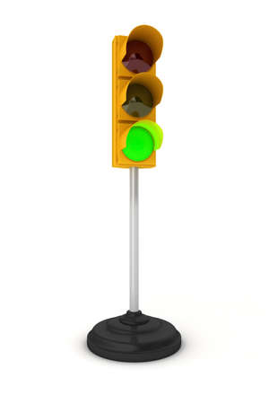 Toy traffic light over white background showing green light photo