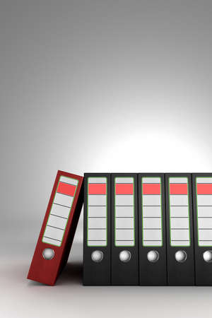 Red ring binder leaning on a row of dark binders Stock Photo - 9670088