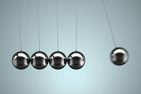 Close-up view of a Newtons Cradle with motion blur photo