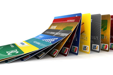 debit card: Fake credit cards in a row falling - credit card debt concept Stock Photo