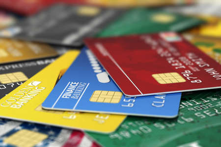 e card: A pile of fictitious credit cards. All logos, banks and names are fake and not real.