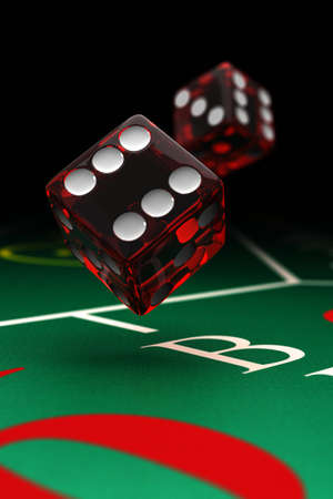 dices: Two dice over a craps table with selective focus Stock Photo