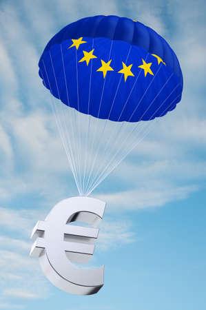 compromisos: Paraca�das con la bandera europea en la que la celebraci�n de un s�mbolo del euro - concepto de fondos de la seguridad para los pa�ses endeudados en Europa Foto de archivo