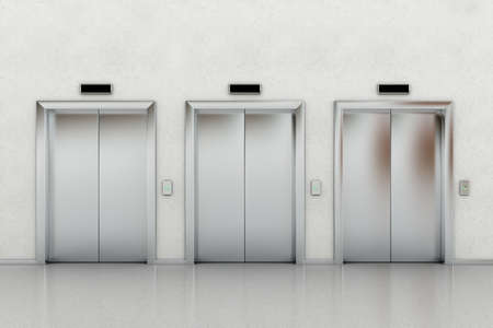 Three closed elevators in a business lobby Stock Photo