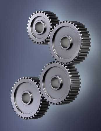 interdependence: Four gear wheels symbolizing perfect teamwork Stock Photo