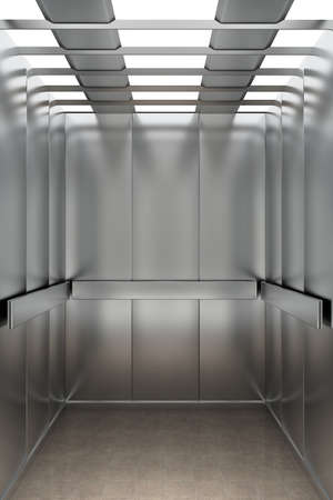 Interior view of a modern elevator facing the back wall photo