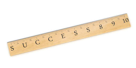 evaluate: A wooden ruler concept used to measure success over white background Stock Photo