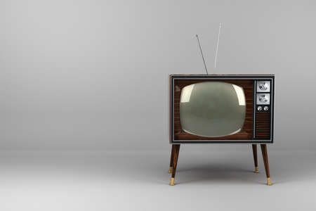 Classic vintage TV with wood veneer design in studio photo