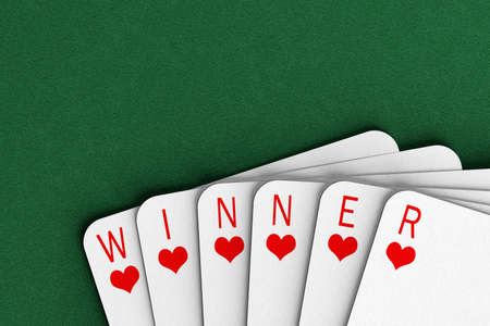fanned: Playing cards on a felt table spelling out the word winner