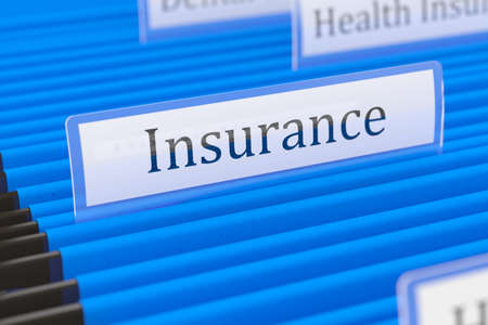 Blue hanging folder with insurance tag on it Stock Photo - 20171812