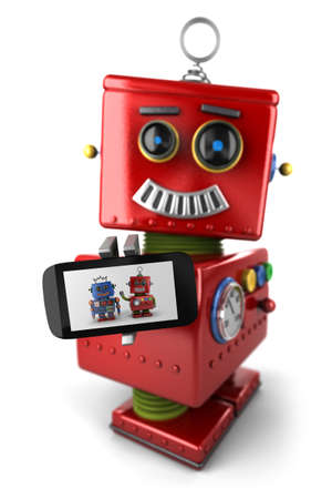 toy phone: Happy vintage toy robot with smartphone over white background Stock Photo
