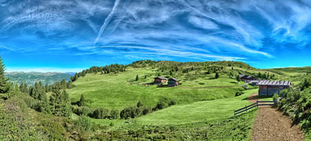 Italian mountain panorama in South Tyrol with chalet, dairy cows and green pastures on a sunny day   photo