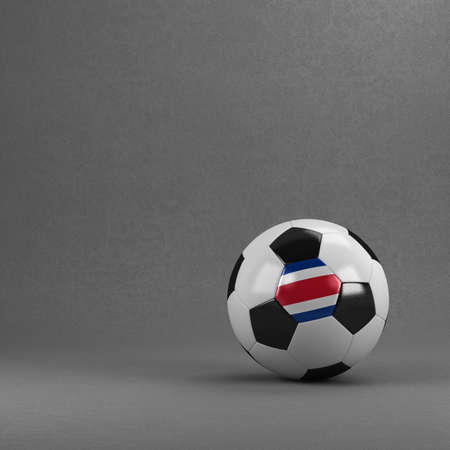 costa rica flag: Costa Rican soccer ball in front of plaster wall Stock Photo
