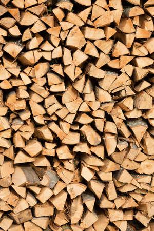 Industrial size pile of split beech wood logs photo