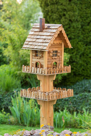 Homemade bird house nexto to a pond in the backyard photo