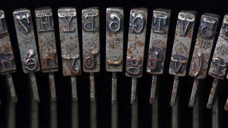 typebar: Super macro shot of rusted and dusty typebars of an old typewriter Stock Photo