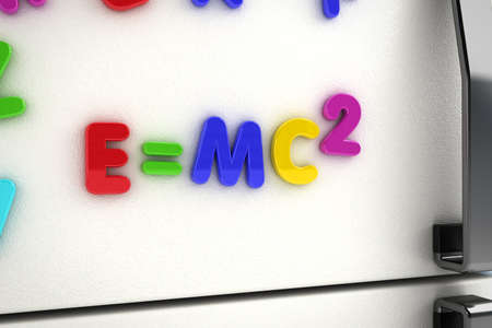 theory of relativity: The mass - energy equivalence written on a refrigerator door with magnet letters Stock Photo