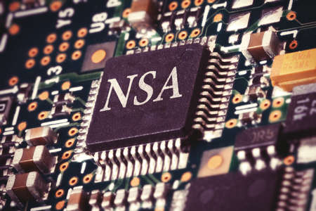 snoop: Conceptual image of a NSA processor inside a computer. Stock Photo