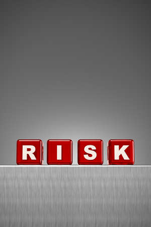 red dice: Red semi transparent dice spelling the word risk on metal surface with gradient background Stock Photo