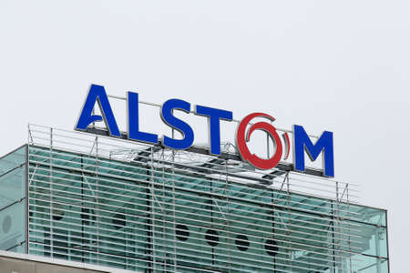 acquisition: BADEN, SWITZERLAND. October 31, 2015. Last days of the Alstom logo on rooftop of thermal power headquarters before merger and acquisition of General Electric on 2nd November 2015.