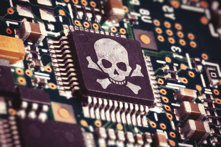 hacker: Macro photo of a circuit board with microchip carrying a pirate symbol