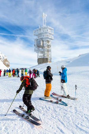 celcius: ENGELBERG, SWITZERLAND. January 18th, 2016. Skiers preparing for a downhill run from the top of Mount Titlis at minus 12 degrees Celcius.