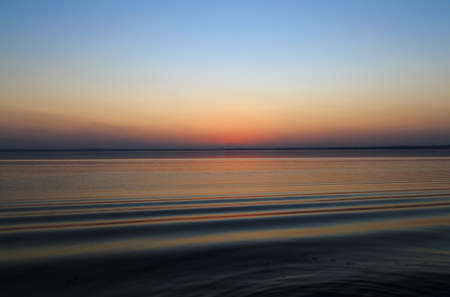 colorful water surface: Waters edge sunset