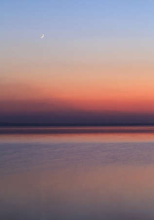 natural force: Near sunset, the moon just rising