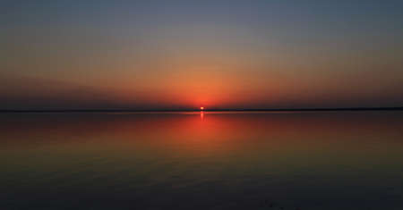colorful water surface: Near charming sunsets