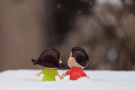 A pair of doll in the snow Stock Photo