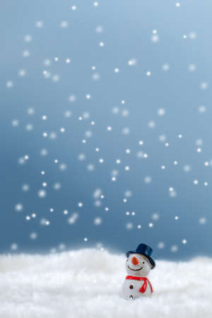 Snowman in the snow Imagens
