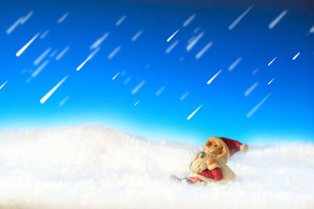 Santa Claus Looks at the meteor shower in the snow Stock Photo