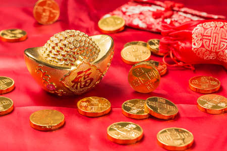 Gold ingots, gold coins and couplets