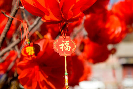 Hanging red lanterns to welcome the new year