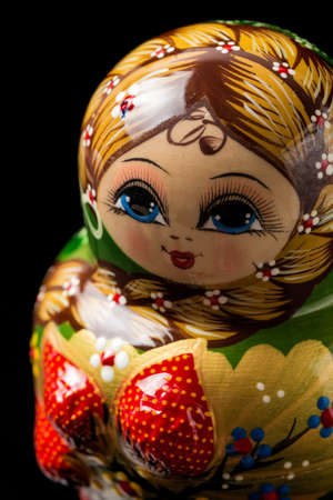 Russian doll on black background