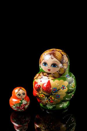 Russian dolls on black background Stockfoto