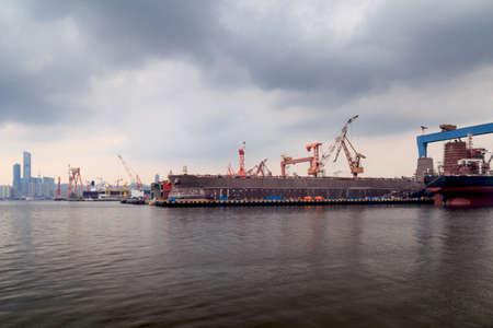 A shipyard in a seaside port
