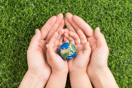 A model of the earth in hand Stock Photo