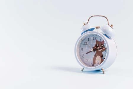 Alarm clock on blue background