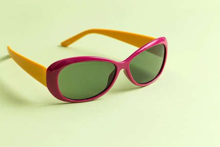 Sunglasses on a green background