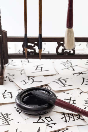Brushes, ink and literacy cards on the table