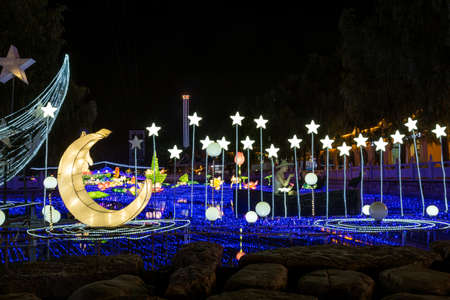 Amusement park night light show