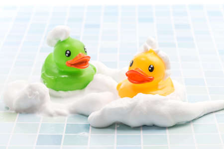 Toy duck taking a bath Imagens