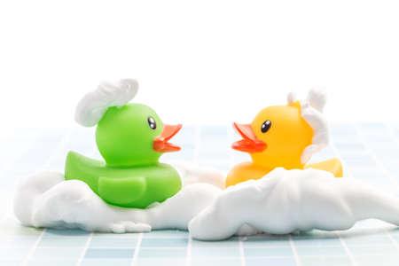 Toy duck taking a bath 免版税图像