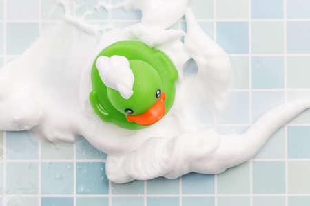 Toy duck taking a bath