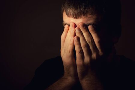 aciculum: Man in depression, hands covered his face Stock Photo