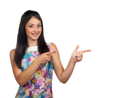 humorously: Isolated young woman is presenting or pointing with her finger.