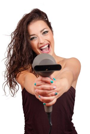 horizontal haircut: Portrait of beautiful young fashion  woman holding hairdryer